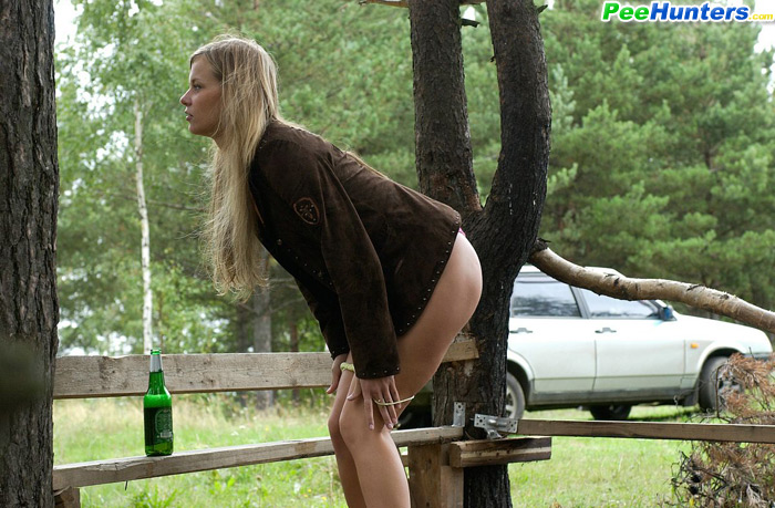 Girl pee standing outdoors there